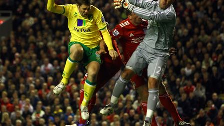 Grant Holt heads home past Pepe Reina in 2011. Picture: Paul Chesterton/Focus Images