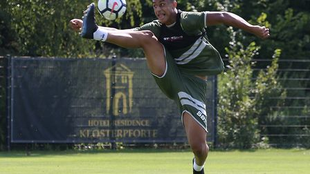 Highly rated striker Adam Idah has signed a new long-term deal with Norwich City - and been promoted