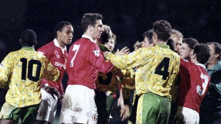 Ruel Fox (10) keeps to the periphery of the scrap as Norwich City do battle with Manchester United a