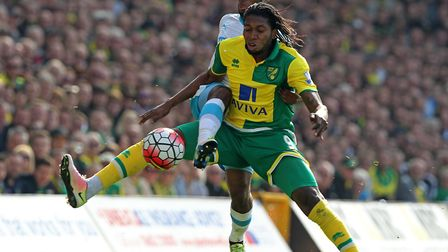 Dieumerci Mbokani of Norwich and Vurnon Anita of Newcastle United in action during the Barclays Prem