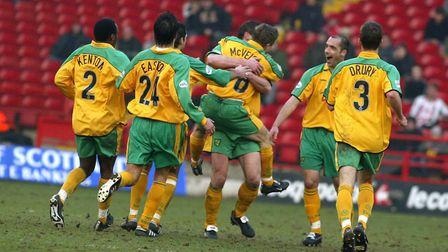 Norwich City players rush to congratulate goal scorer Paul McVeigh in 2003 Picture: Archant
