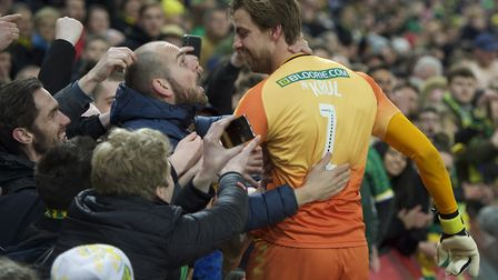 Tim Krul celebrates with the Norwich City fans after winning promotion back to the Premier League at