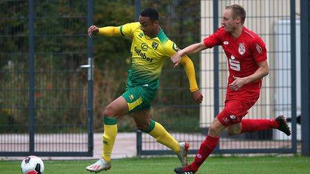 Adam Idah of Norwich and Nico Perrey of SC Bonner in action during the Pre-season friendly match at