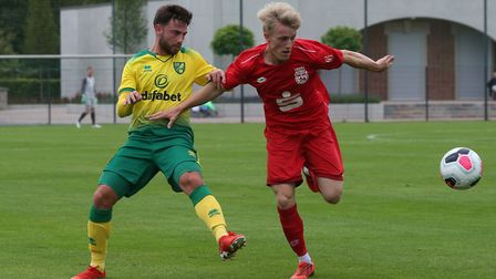 Patrick Roberts of Norwich and Jasper Loffelsand of SC Bonner in action during the Pre-season friend