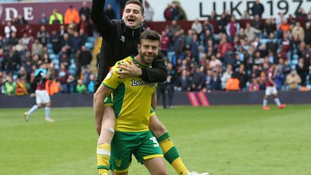 Kenny McLean takes a lift from Grant Hanley as Norwich City celebrate their Championship title succe