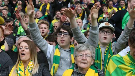 The travelling Norwich fans celebrate victory at Aston Villa which secured the Championship title Pi