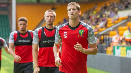 Timm Klose, followed by Marco Stiepermann and Ben Godfrey, during an open training session at Carrow