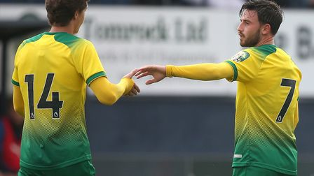 Patrick Roberts, right, is congratulated by Todd Cantwell after putting Norwich 5-1 up at Luton Pict
