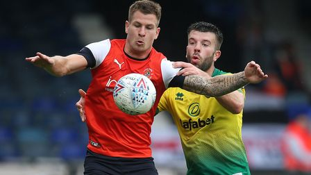James Collins of Luton Town and Grant Hanley of Norwich in action during the Pre-season friendly mat