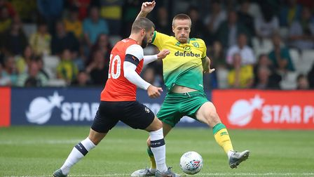Elliot Lee of Luton Town and Marco Stiepermann of Norwich in action during the Pre-season friendly m