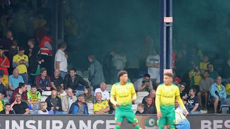 A flare is let off in the Norwich end during the Pre-season friendly match at Kenilworth Road, Luton