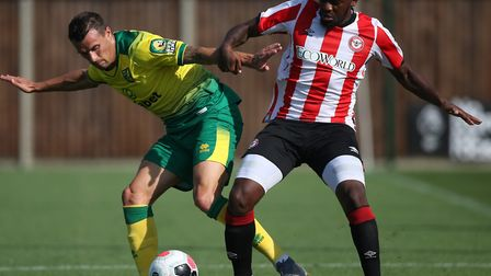 Philip Heise tussles for possession in Norwich City's midweek friendly against Brentford Picture: Pa