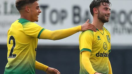 Patrick Roberts, right, is congratulated by Max Aarons after firing Norwich 5-1 up at Luton Picture: