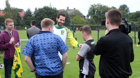 The Norwich players, including Mario Vrancic, meet the fans during an open training session at Hotel