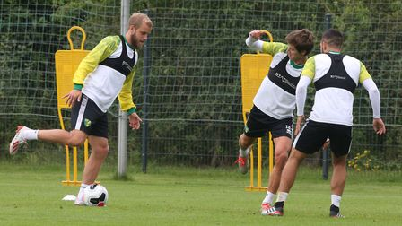 Teemu Pukki of Norwich, Todd Cantwell of Norwich and Emiliano Buendia of Norwich during Norwich City