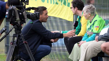 Norwich fan Lil Kemp is interviewed by Sky Sports Germany during Norwich City training at Hotel-Resi
