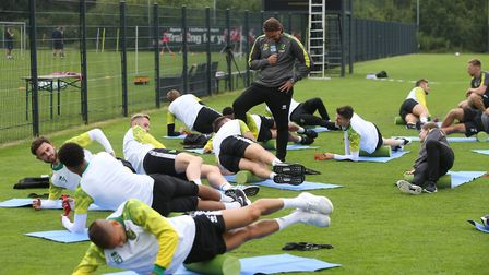 City's players foam roll during an open training session yesterday