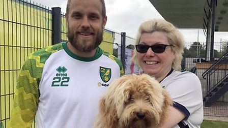 Teemu Pukki of Norwich City meets Teemu the dog of the Bowles family during an open training session