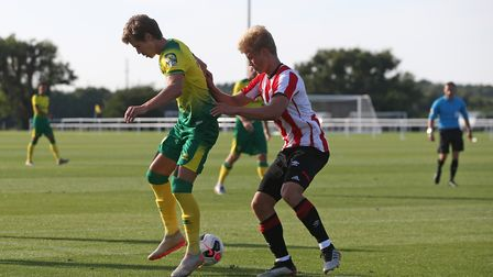 Todd Cantwell of Norwich backless the ball to Max Aarons of Norwich during the Pre-season friendly m