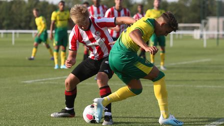 Jaakko Oksanen of Brentford and Max Aarons of Norwich in action during the Pre-season friendly match