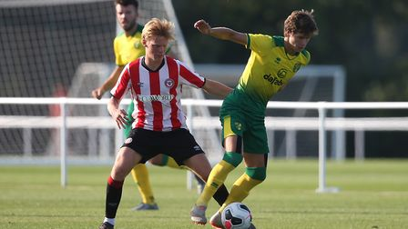 Jaakko Oksanen of Brentford and Todd Cantwell of Norwich in action during the Pre-season friendly ma