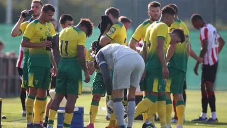 Norwich players take on fluids and try to stay cool in the 32 degrees heat during the pre-season fri
