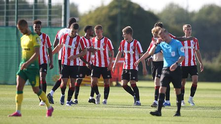 The Brentford players celebrate their sideÕs 2nd goal during the Pre-season friendly match at Colney
