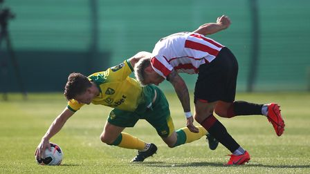 Sam Byram of Norwich and Emiliano Marcondes Camargo Hansen of Brentford in action during the Pre-sea