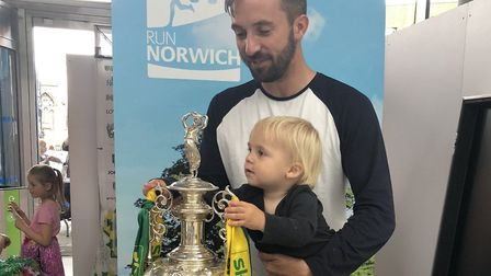 Michael Bailey with the EFL Championship trophy and one of his sons. Picture: Submitted