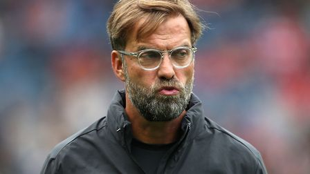 Liverpool manager Jurgen Klopp is not happy he has to kick off on Friday against Norwich City Pictur