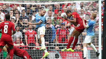 Liverpool's Joel Matip scores his side's first goal of the game during the Community Shield match at