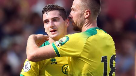 Norwich City midfielder Kenny McLean, left, is congratulated on his goal against Toulouse by Marco S