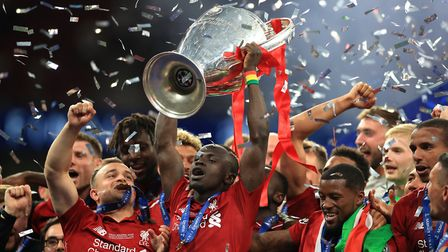 Sadio Mane lifts the Champions League trophy - next up are Norwich City Picture: PA