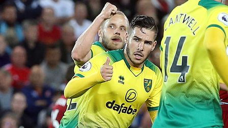 Up and running - Teemu Pukki, left, and Emi Buendia signal to the travelling City fans after scoring