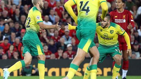 Teemu Pukki is congratulated by Emi Buendia after pulling a goal back for Norwich City at Liverpool