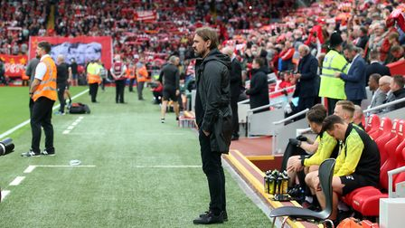 Norwich City head coach Daniel Farke watches on as Liverpool fans sing their anthem 'You'll Never Wa