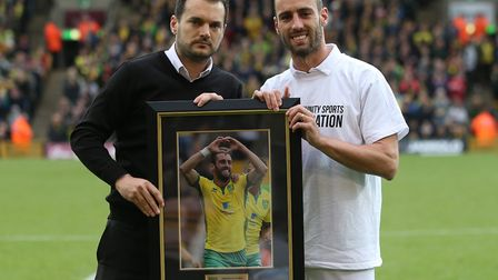 Sporting director Stuart Webber presented Ivo Pinto with a framed photo as the full-back's Norwich C