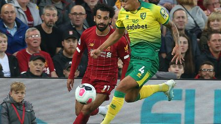 Norwich City defender Ben Godfrey duels with Liverpool striker Mo Salah Picture: Paul Chesterton/Foc