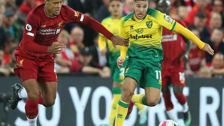 Emi Buendia leads the charge for Norwich City with Virgil van Dijk in hot pursuit Picture: Paul Ches