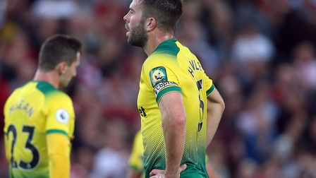 Grant Hanley gathers his thoughts after Norwich City concede a third at Liverpool Picture: Paul Ches