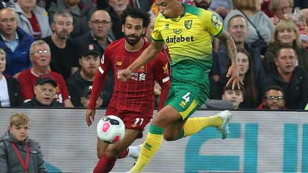 Canaries defender Ben Godfrey holds off pressure from Liverpool superstar Mo Salah Picture: by Paul