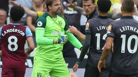 Norwich City keeper Tim Krul congratulates Christoph Zimmermann on a superb tackle which denied West