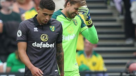Ben Godfrey and Tim Krul, right, react to West Ham's first goal during Norwich City's 2-0 loss at th