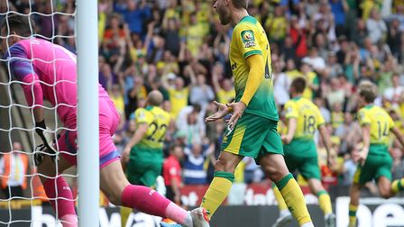 Teemu Pukki completes his Norwich City hat-trick - and Tom Trybull leads the celebrations Picture::