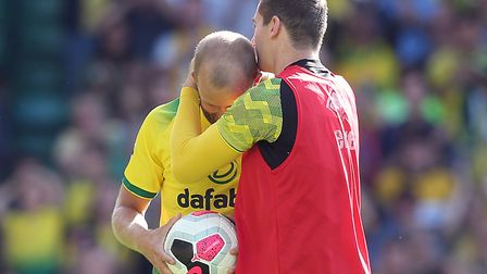 Teemu Pukki gets a kiss from Kenny McLean after his hat-trick in Norwich City's 3-1 Premier League w