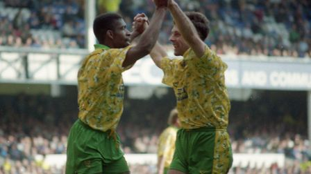 Efan Ekoku, left, celebrates scoring during a 5-1 win at Everton in September 1993 in which he score