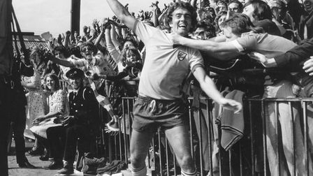 Ted MacDougall scored two top-flight hat-tricks for the Canaries, pictured celebrating on his way to