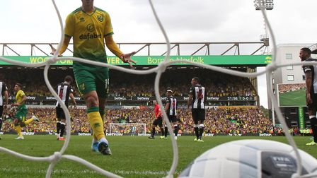 Tom Trybull savours Teemu Pukki's opening Norwich City goal in the 3-1 Premier League win against Ne