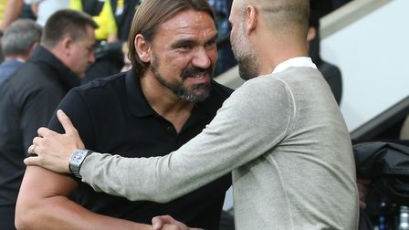 Norwich City head coach Daniel Farke greets Manchester City manager Pep Guardiola before kick-off Pi