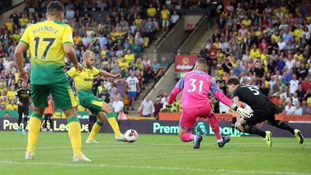 Teemu Pukki of Norwich scores his sides 3rd goal during the Premier League match at Carrow Road, Nor